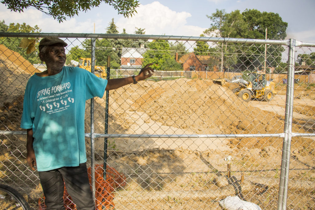 Ray Twiggs stands beside the Park Hill Commons development site where his home and family's restaurant once stood on Fairfax Street. North Park Hill, Aug. 7, 2018. (Kevin J. Beaty/Denverite)
