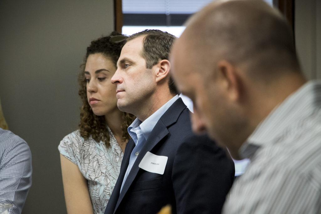 U.S. House of Representatives canidate Jason Crow listens as Jared Polis addresses a group of veterans in Denver, Aug. 7, 2018. (Kevin J. Beaty/Denverite)