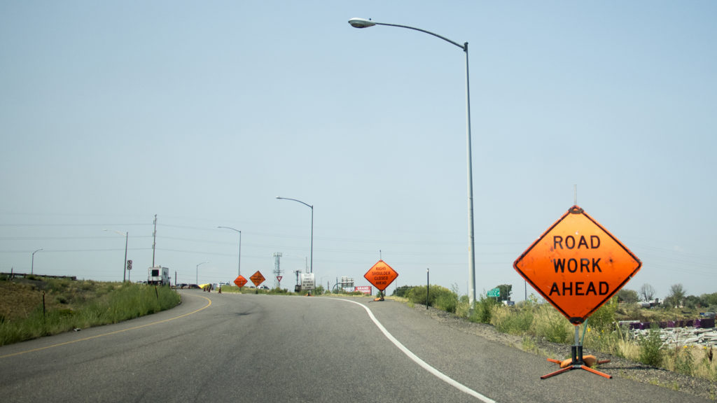 """Road Work Ahead,"" seen on an onramp to I-70, Aug. 13, 2018. (Kevin J. Beaty/Denverite)"