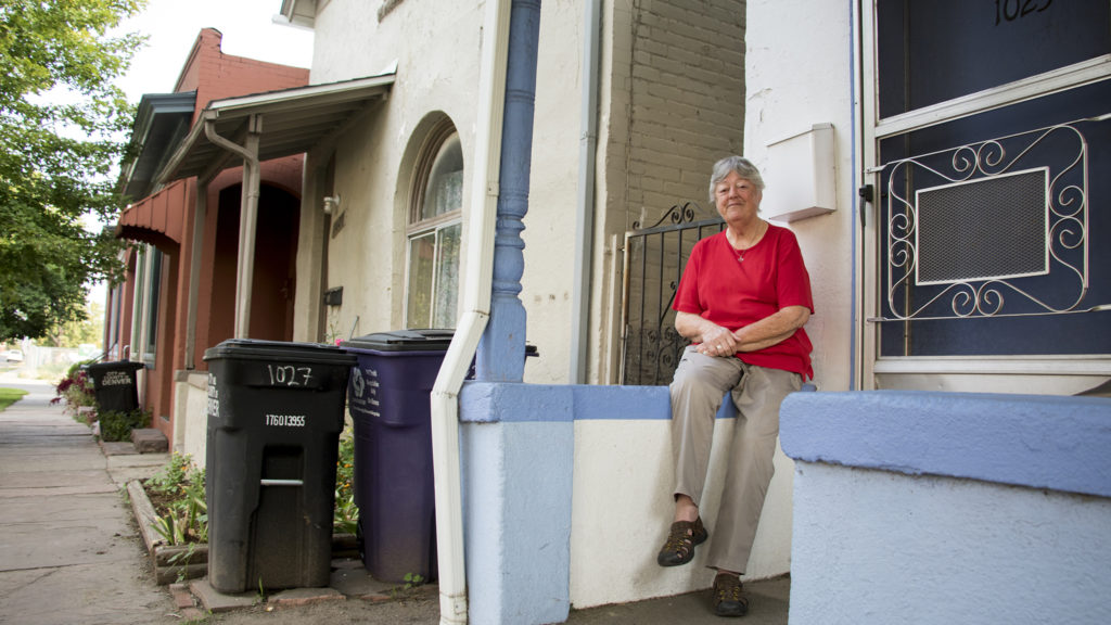 Sister Anna Koop poses for a portrait outside of the row of affordable units in Five Points owned by the Denver Catholic Workers House, Aug. 14, 2018. (Kevin J. Beaty/Denverite)