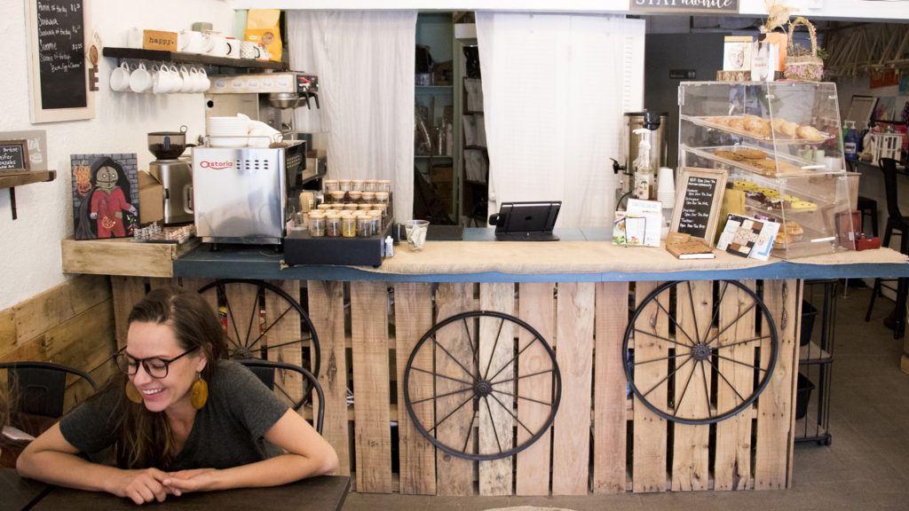 Open Door Tea Shop owner Kristin Cardenas speaks to a reporter in her Cole establishment, Aug. 14, 2018. (Kevin J. Beaty/Denverite)
