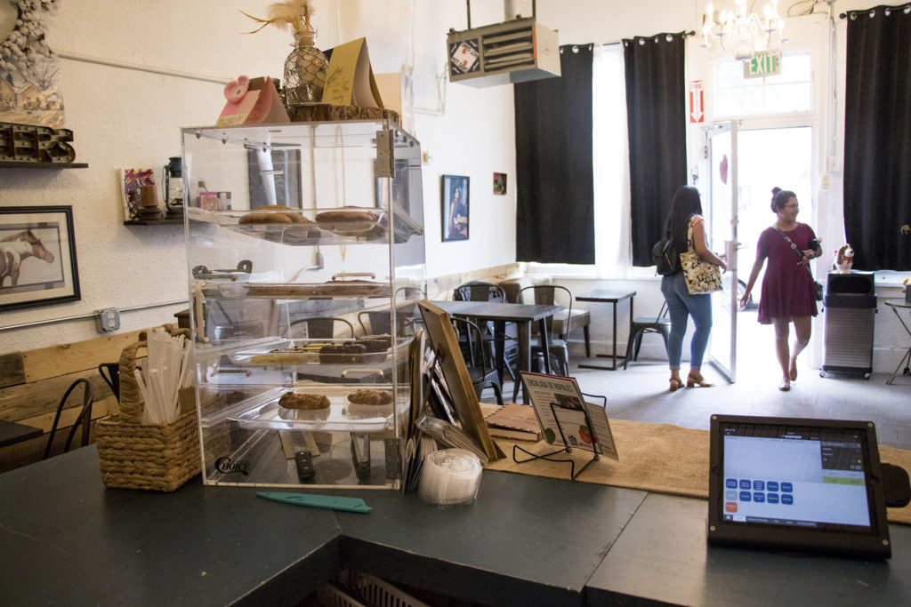 Patty Moncada and Wendy Luna walk into Open Door Tea Shop in Cole, Aug. 14, 2018. (Kevin J. Beaty/Denverite)