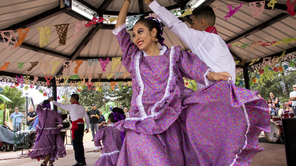 The dance group Sangre de Mexico performs as Westwood Park is rededicated, Aug. 18, 2018. (Kevin J. Beaty/Denverite)