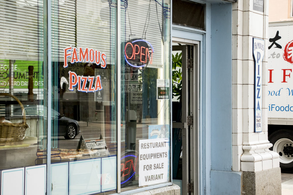 Famous Pizza and two properties next door are up for lease on Broadway, Aug. 21, 2018. (Kevin J. Beaty/Denverite)