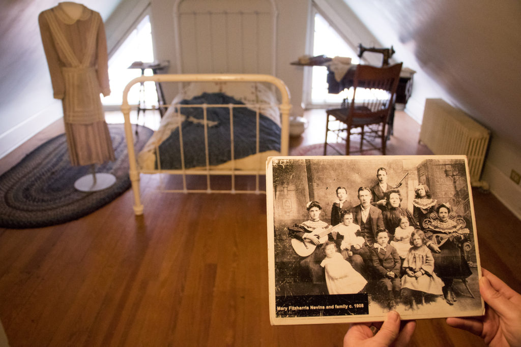 A servant's room upstairs is one new feature inside the house. That's Mary Fitzharris Nevins, an Irish immigrant who once slept here, and her rather large family. Three years of renovations on the Molly Brown House are finally complete, Aug. 21, 2018. (Kevin J. Beaty/Denverite)
