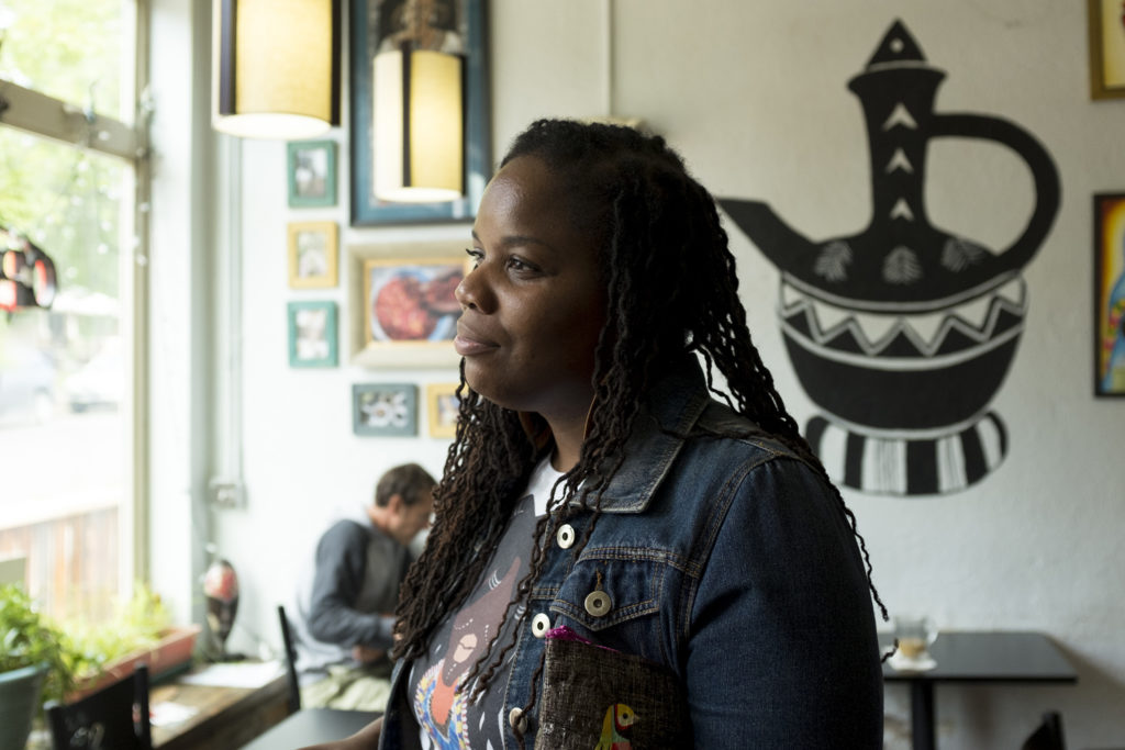 China Tolliver hangs out in Whittier Cafe, Aug. 22, 2018. (Kevin J. Beaty/Denverite)
