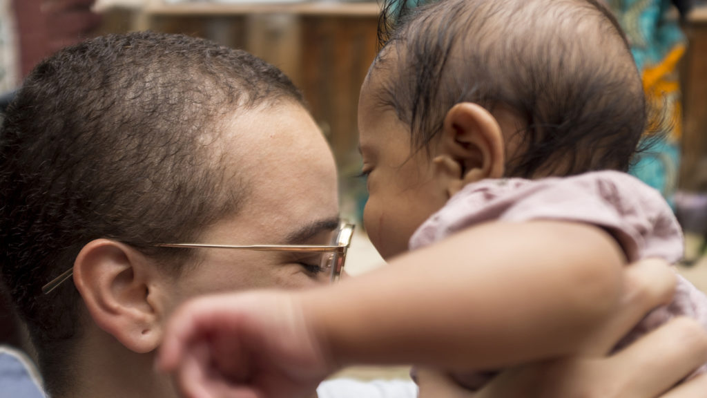 Avery Rao holds her son  Thao Vishnu at the Whittier Cafe as she discusses Denver Black and Latina Breastfeeding Week, Aug. 22, 2018. (Kevin J. Beaty/Denverite)