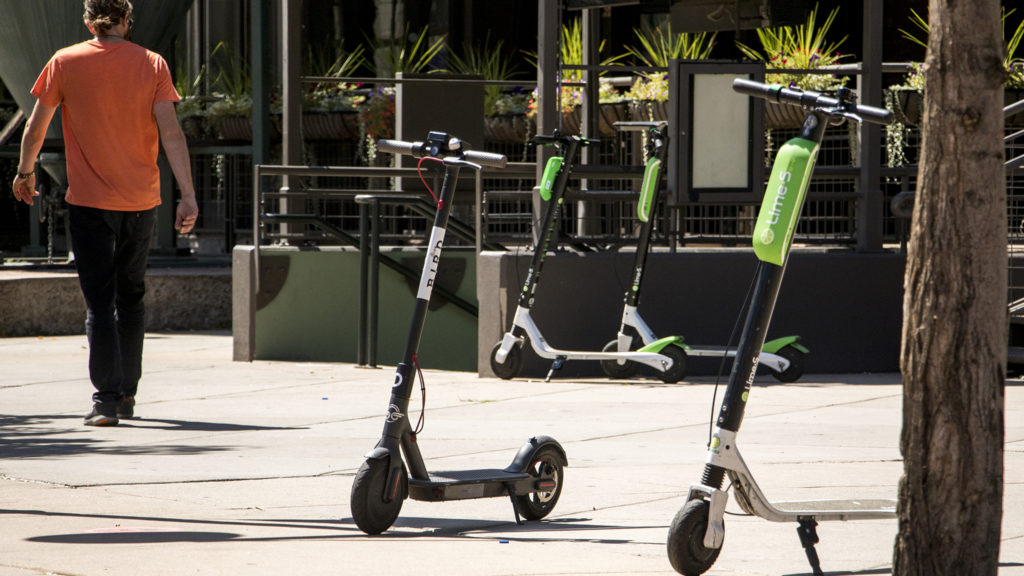 Bird and Lime scooters parked near Coors Field, Aug. 27, 2018. (Kevin J. Beaty/Denverite)