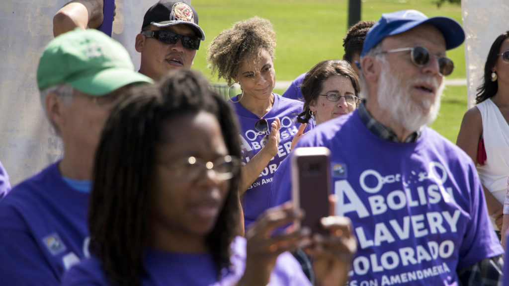 """Elisabeth Epps attends a rally to vote """"yes"""" on Amendment A, to make slavery unconstitutional in Colorado, at City Park, Aug. 28, 2018. (Kevin J. Beaty/Denverite)"""
