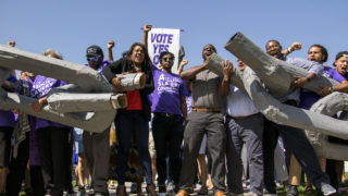 """Activists break the chains of a giant pair of shackles after a rally to vote """"yes"""" on Amendment A, to make slavery unconstitutional in Colorado, at City Park, Aug. 28, 2018. (Kevin J. Beaty/Denverite)"""