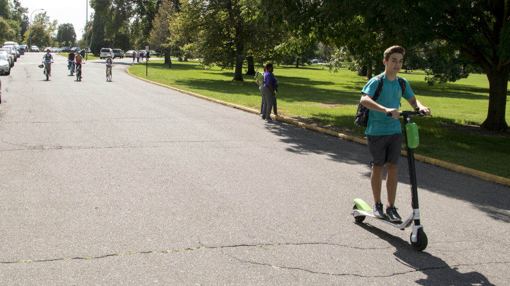A dockless scooter in action at City Park, Aug. 28, 2018. (Kevin J. Beaty/Denverite)