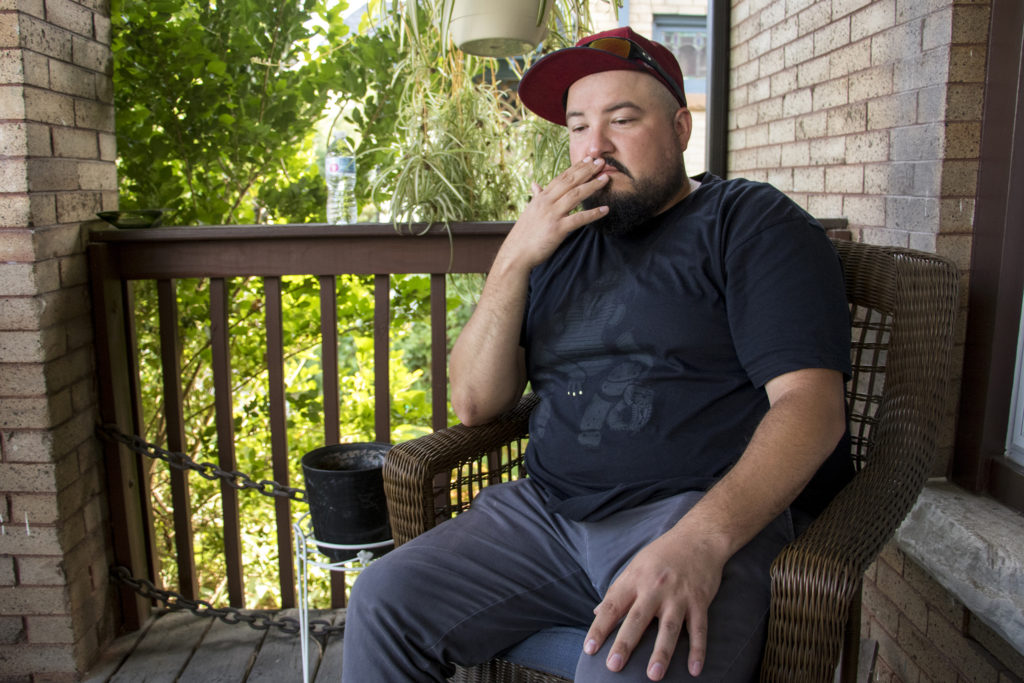 David Torres sits on the front porch of his new home in Whittier, Aug. 28, 2018. (Kevin J. Beaty/Denverite)