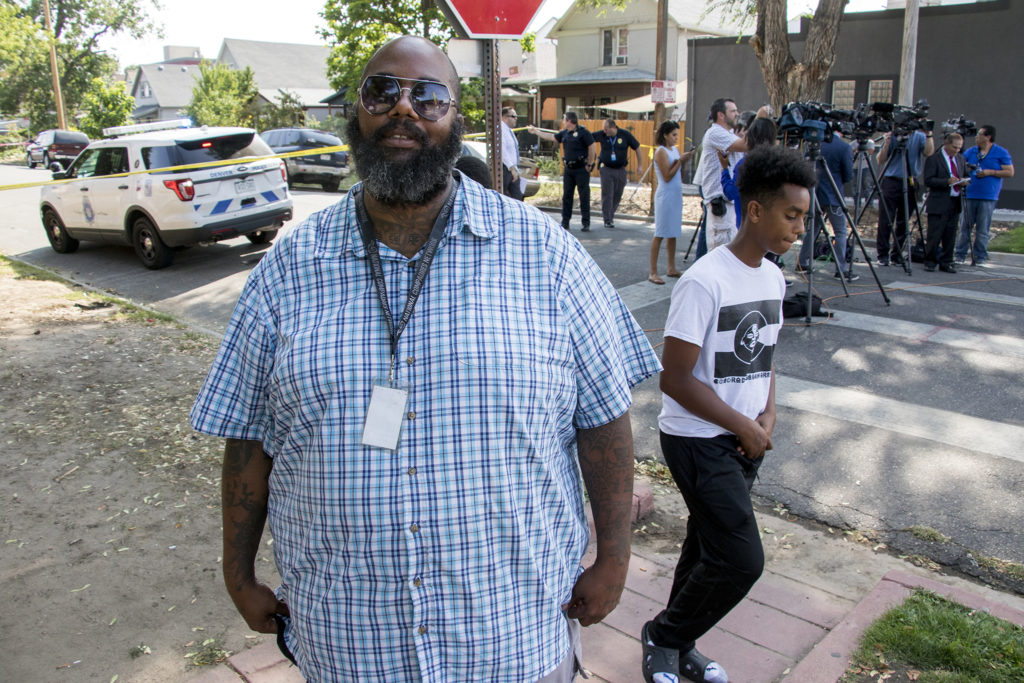 Jason McBride, program assistant with the Gang Rescue and Support Project, arrived at the scene of a shooting near the DSST Cole middle school at the Mitchell building to provide resources to families if need be, Aug. 28, 2018. (Kevin J. Beaty/Denverite)