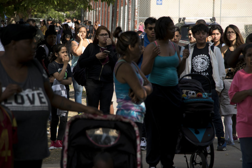 Parents wait for their kids' release from lockdown after a shooting near the DSST Cole middle school at the Mitchell building, Aug. 28, 2018. (Kevin J. Beaty/Denverite)