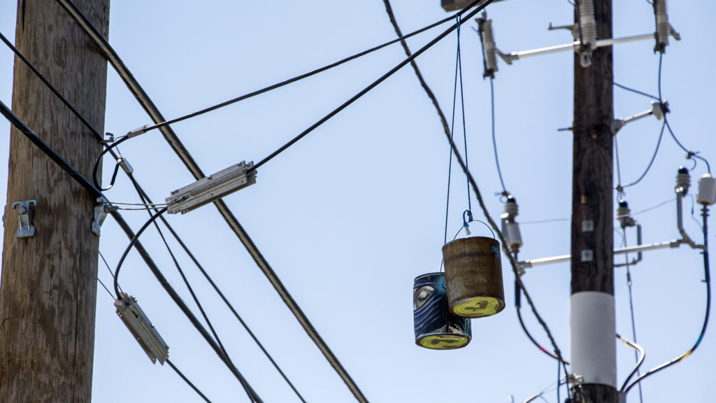 Paint cans hang over a RiNo alleyway. Five Points, Aug. 29, 2018. (Kevin J. Beaty/Denverite)