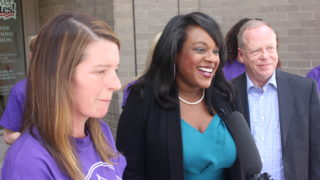 Rep. Leslie Herod (center) on August 2, when Caring 4 Denver dropped off signatures for their ballot measure. (Courtesy Caring 4 Denver)