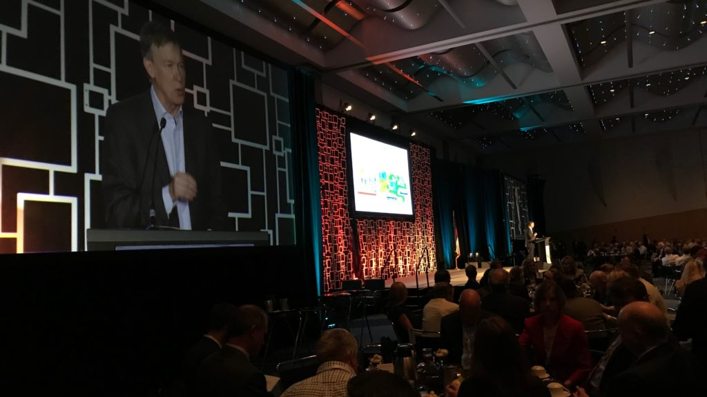 Gov. John Hickenlooper speaks during the Energy Summit luncheon at the Denver Convention Center on Tuesday, August, 21, 2018. (Esteban L. Hernandez/Denverite)