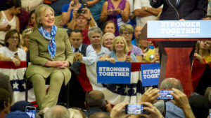 John Hickenlooper and Hillary Clinton at a rally in Commerce City. August 3, 2016. (Kevin J. Beaty/Denverite)