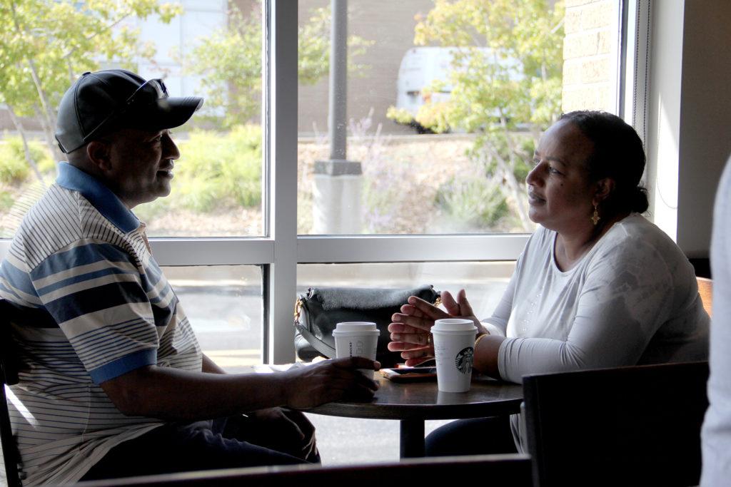 Girum Alemayehu and Elizabeth Moltot chat at a coffee shop on Monday, Sept. 10, in Aurora. (Esteban L. Hernandez/Denverite)