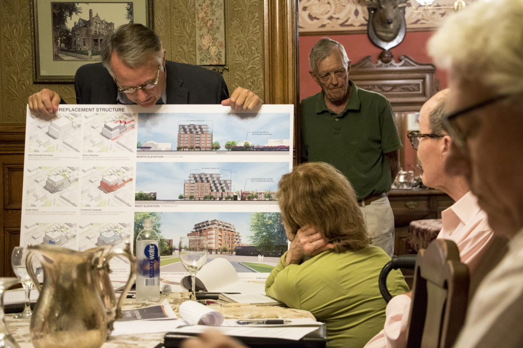 Architect Chris Shears shows a rendering of one potential use of a historic block at E. Colfax Avenue and Franklin Street. Capitol Hill United Neighbors' historic preservation committee meets inside Castle Marne, Aug. 27, 2018. (Kevin J. Beaty/Denverite)