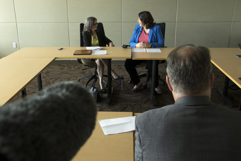 Denver City Attorney Kristin Bronson (left) and Britta Fisher, chief housing officer at Denver's Office of Economic Development, speak to the press inside the Wellington Webb Building, Sept. 5, 2018. (Kevin J. Beaty/Denverite)
