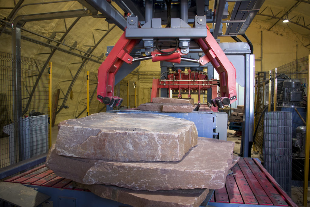 A giant, automated stone cutting machine at Lyons Sandstone, Sept. 7, 2018. (Kevin J. Beaty/Denverite)
