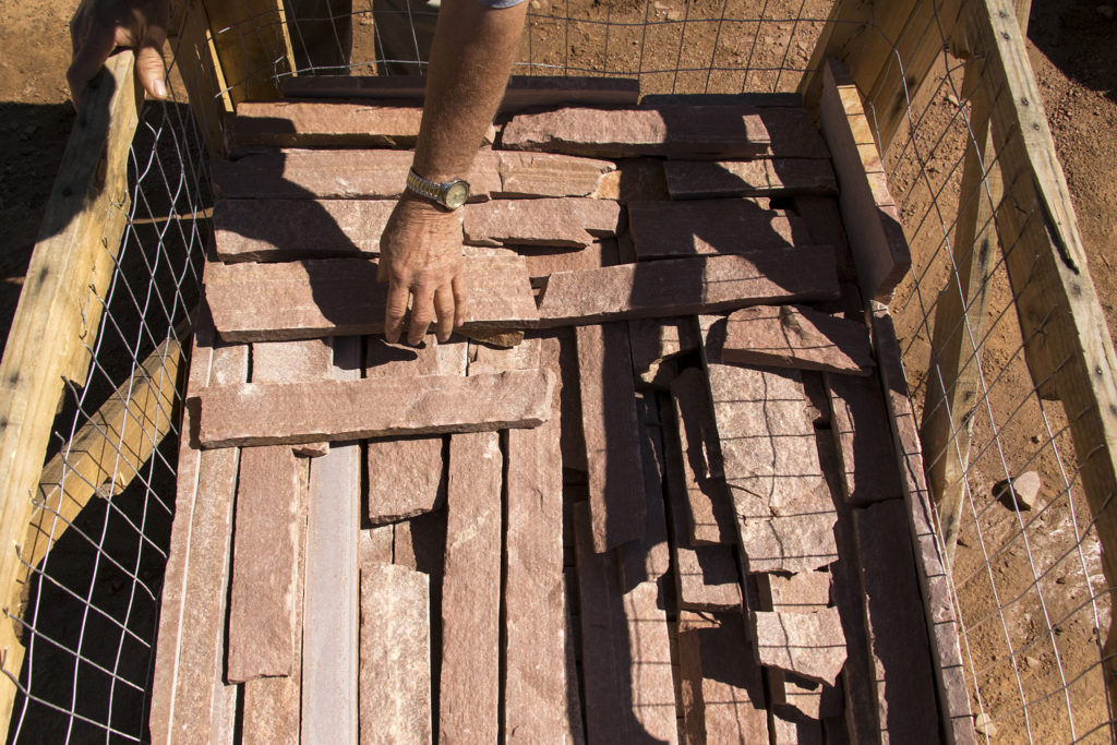 Thin-cut red sandstone quarried here at Lyons Sandstone, Sept. 7, 2018. (Kevin J. Beaty/Denverite)