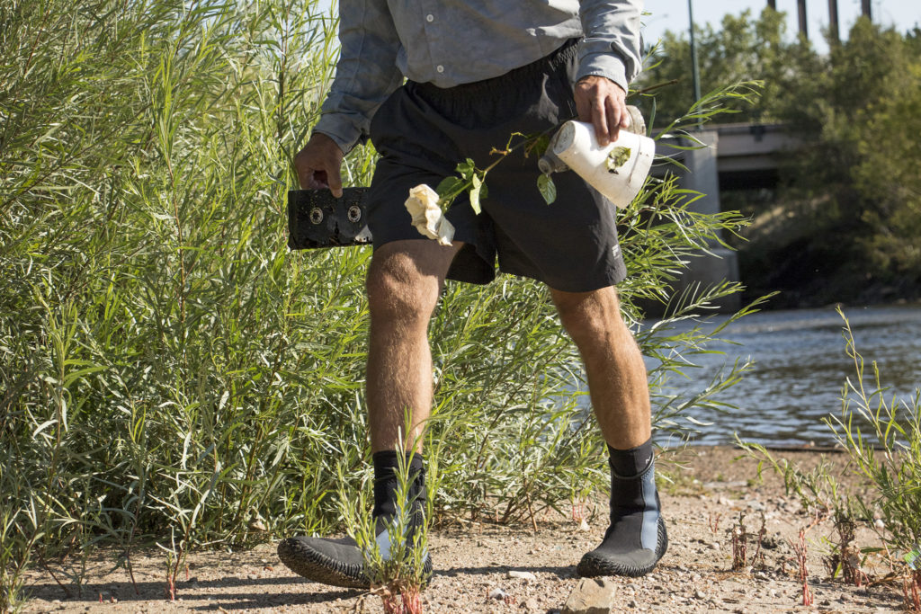 """""""Don't take pictures of the trash,"""" said Mark Grassel, a scorekeeper in Denver Trout Unlimited's 12th annual Carpslam flyfishing tournament on the South Platte River, Sept. 9, 2018. (Kevin J. Beaty/Denverite)"""