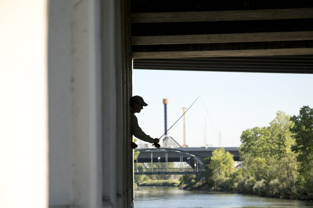 Barry Howsden stands beneath an underpass in his quest to hook a carp. Denver Trout Unlimited's 12th annual Carpslam flyfishing tournament on the South Platte River, Sept. 9, 2018. (Kevin J. Beaty/Denverite)