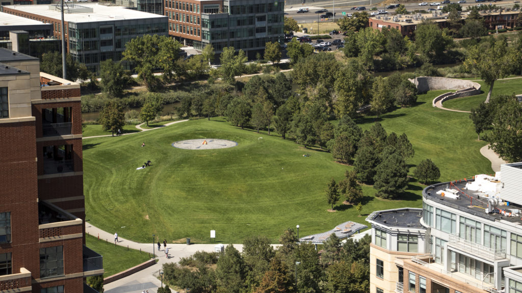 """The hill in Commons Park known colloquially as """"stoner hill,"""" seen from atop the DaVita Kidney Care building downtown, Sept. 9, 2018. (Kevin J. Beaty/Denverite)"""