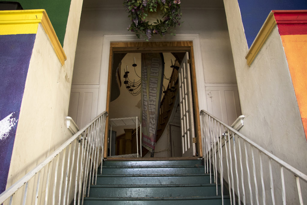 The old entryway to a historic home on East Colfax Avenue, that has since been obsured from the street by commercial additions, Sept. 14, 2018. (Kevin J. Beaty/Denverite)