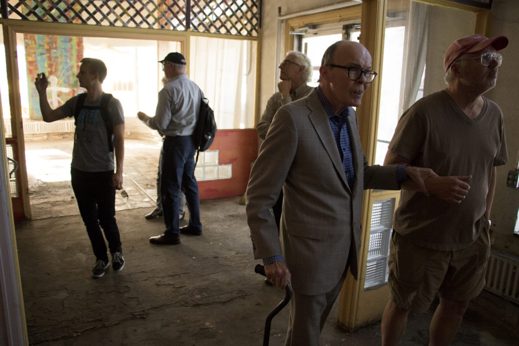 Michael Henry, chair of Capitol Hill United Neighbors' preservation committee, is led into a historic home on East Colfax Avenue, Sept. 14, 2018. (Kevin J. Beaty/Denverite)