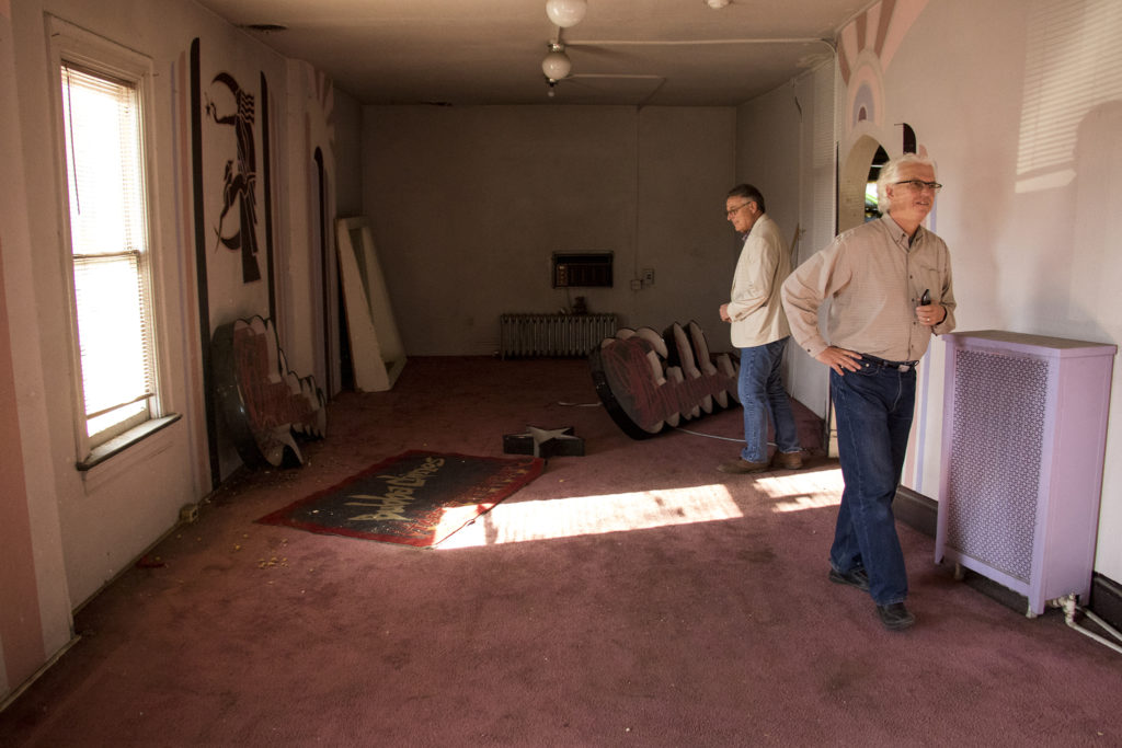 Architects Chris Shears (left) and David Wise tour a historic home on East Colfax Avenue that was later used as a fur garment shop, Sept. 14, 2018. (Kevin J. Beaty/Denverite)
