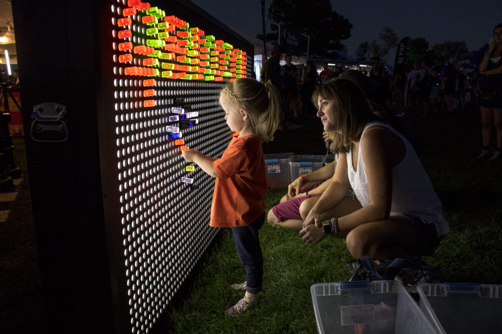 Camille Ziccardi and her daughter Mae play with a giant Lite Brite at Grandoozy at Overland Golf Course, Sept. 14, 2018. (Kevin J. Beaty/Denverite)