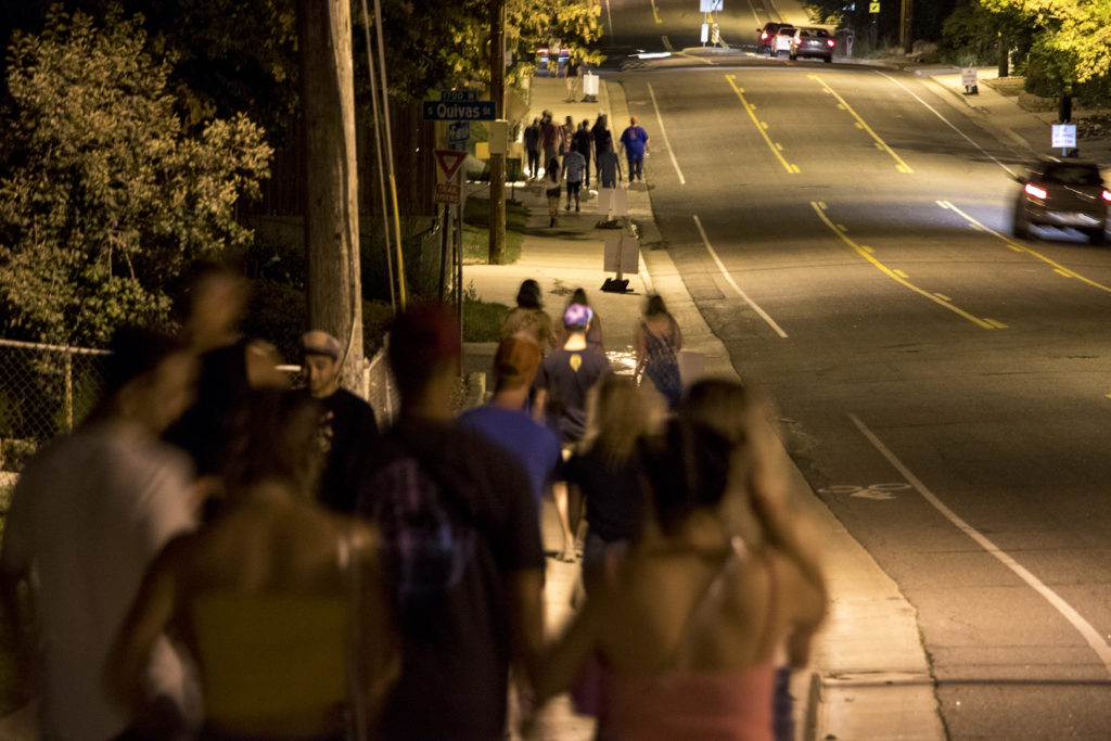 Festivalgoers walk through Ruby Hill after Grandoozy at Overland Golf Course, Sept. 14, 2018. (Kevin J. Beaty/Denverite)