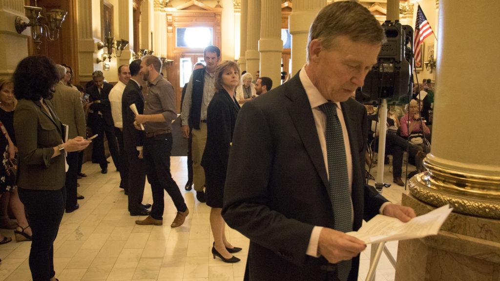 Governor John Hickenlooper enters the room to announce the start of Lifelong Colorado, Sept. 18, 2018. (Kevin J. Beaty/Denverite)