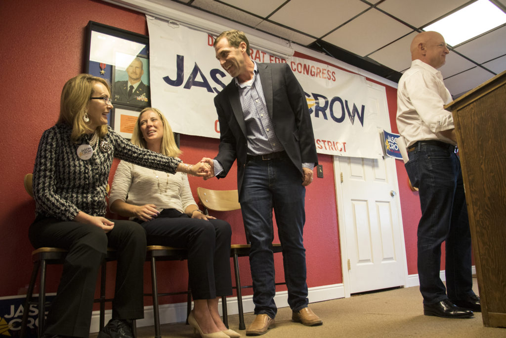 Congressional candidate Jason Crow shakes hands with former congresswoman Gabrielle Giffords durinf a campaign rally at a VFW post in Aurora, Sept. 20, 2018. (Kevin J. Beaty/Denverite)
