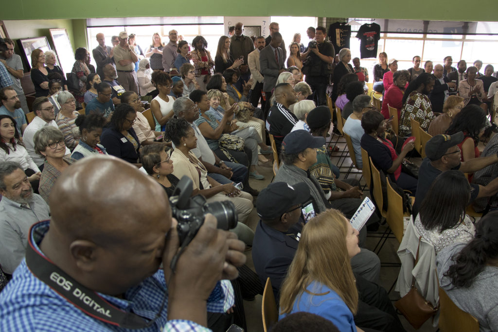 Brother Jeff Fard's cultural center is packed during a panel with Attorney General Eric Holder, Democratic candidate for Colorado Secretary of State Jena Griswold and U.S. Attorney John Walsh, Sept. 27, 2018. (Kevin J. Beaty/Denverite)