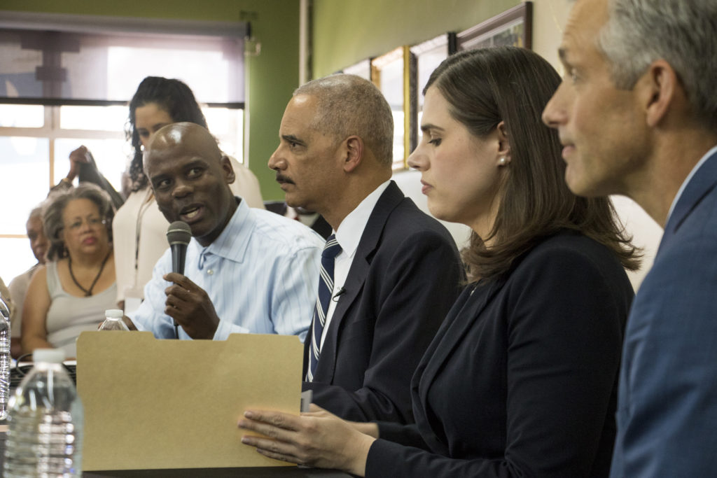 Brother Jeff Fard hosts former Attorney General Eric Holder, Democratic candidate for Colorado Secretary of State Jena Griswold and U.S. Attorney John Walsh at his cultural center in Five Points, Sept. 27, 2018. (Kevin J. Beaty/Denverite)
