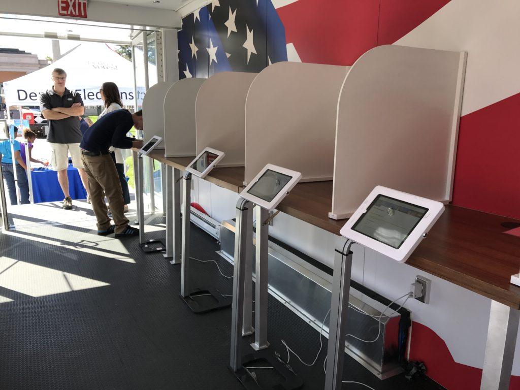 Inside the Denver Elections Division's mobile voting center Haul-N-Votes on Tuesday, Sept. 25, 2018, at Civic Center Park in Denver. (Esteban L. Hernandez/Denverite)