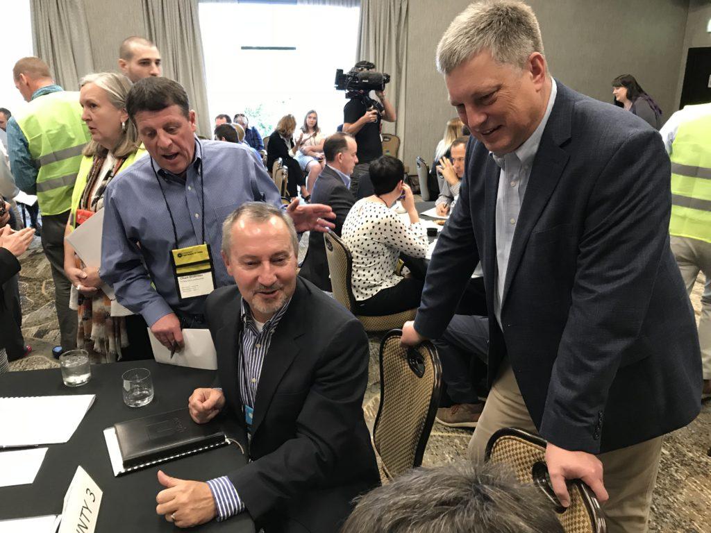 Colorado Secretary of State Wayne Williams (far right) participates in an election preparedness exercise on Thursday, Sept. 5, at the Hilton Denver Inverness in Englewood. (Esteban L. Hernandez/Denverite)