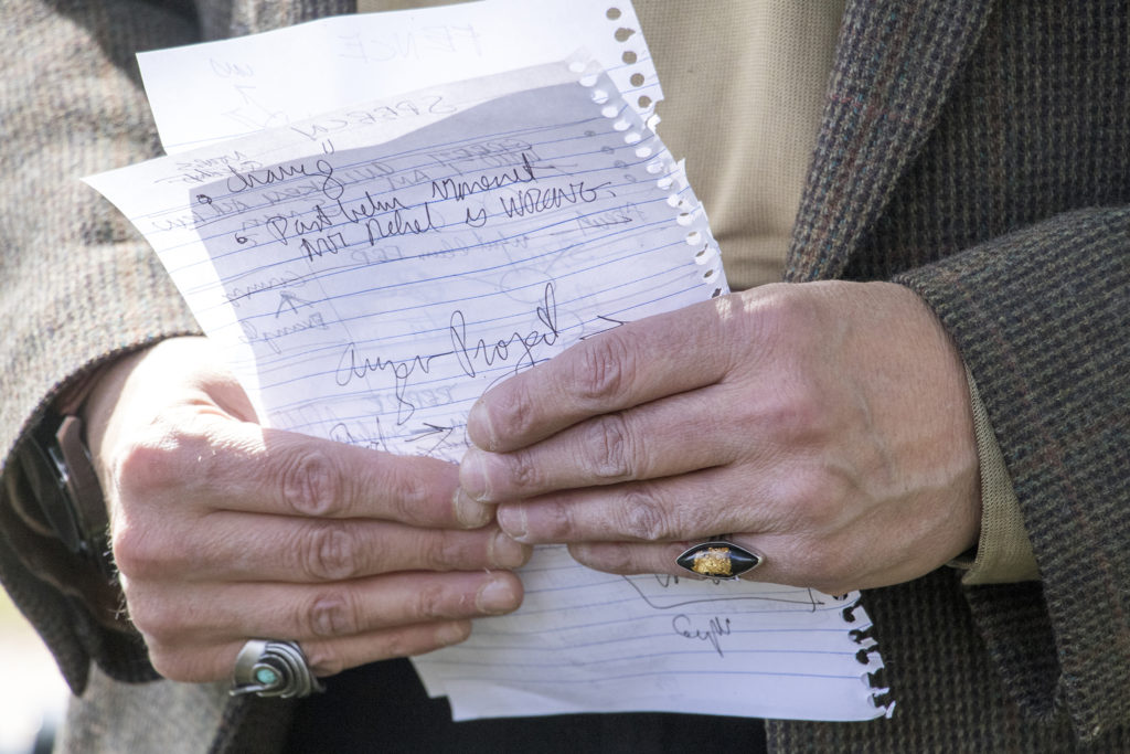 Gregorio Alcaro holds tour notes while wearing a ring with a gold flake embedded in it. Auraria Ninth Street Historic District, Sept. 27, 2018. (Kevin J. Beaty/Denverite)