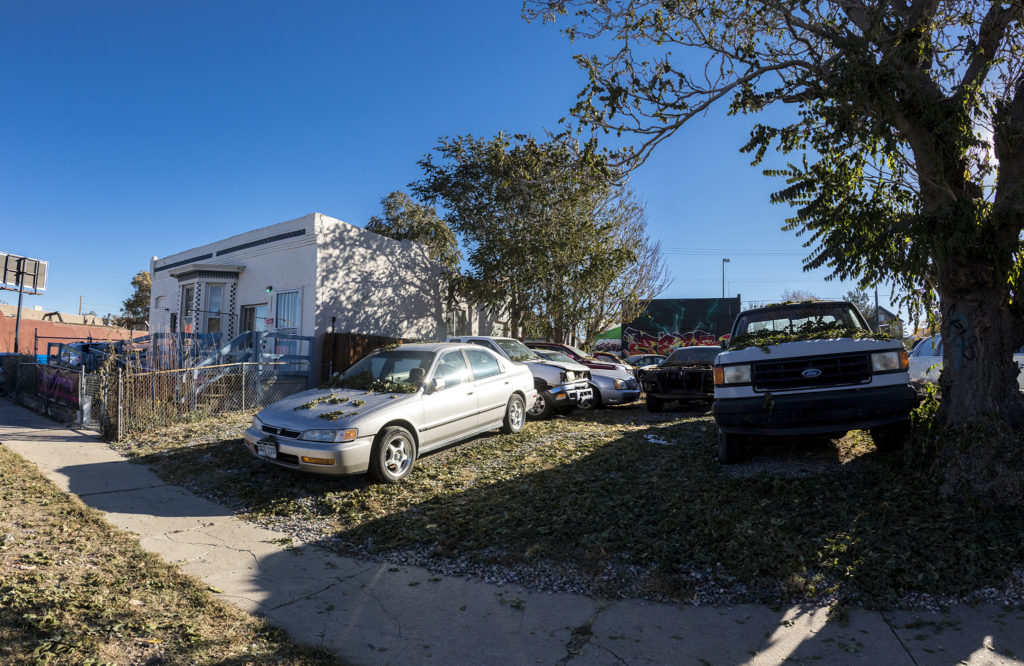 Used cars for sale on Downing Street in Cole, Oct. 16, 2018. (Kevin J. Beaty/Denverite)
