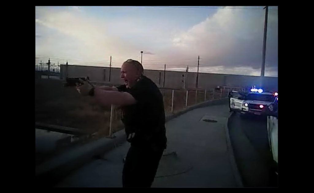 A frame from Denver Police body camera footage showing an officer with his weapon drawn. (Source: Denver Police Department)