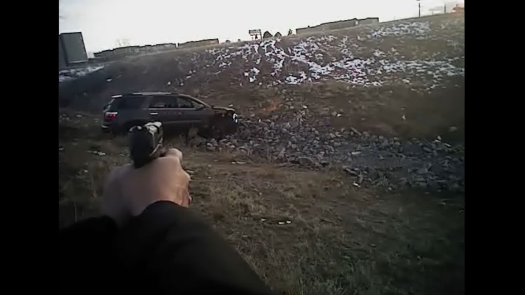 A body camera worn by Officer Austin Barela shows him firing on a vehicle. (Source: Denver Police Department)