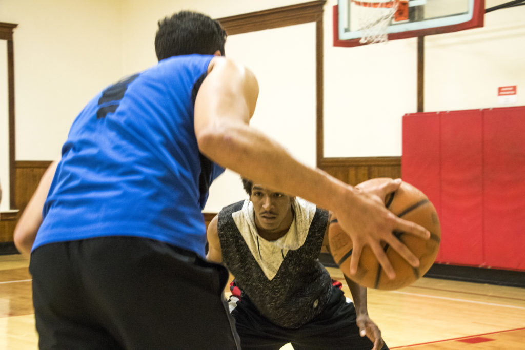 Jovan Robinson guards Sheldon Collins during a pick-up basketball game at the Twentieth Street Recreation Center downtown, Oct. 16, 2018. (Kevin J. Beaty/Denverite)