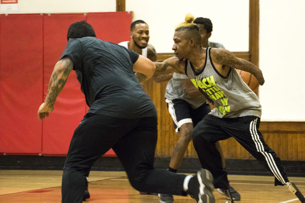 Timothy Wyatt (right) guards Marquis Pimentel during a pick-up basketball game at the Twentieth Street Recreation Center downtown, Oct. 16, 2018. (Kevin J. Beaty/Denverite)