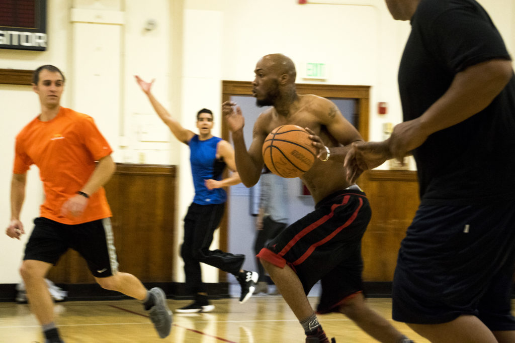 Joseph Anderson runs the ball to the basket during a pick-up basketball game at the Twentieth Street Recreation Center downtown, Oct. 16, 2018. (Kevin J. Beaty/Denverite)