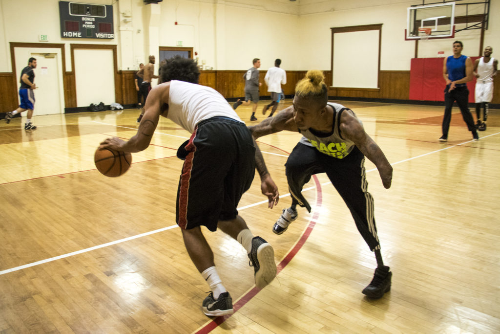 Timothy Wyatt (right) guards DeVarre Wright during a pick-up basketball game at the Twentieth Street Recreation Center downtown, Oct. 16, 2018. (Kevin J. Beaty/Denverite)