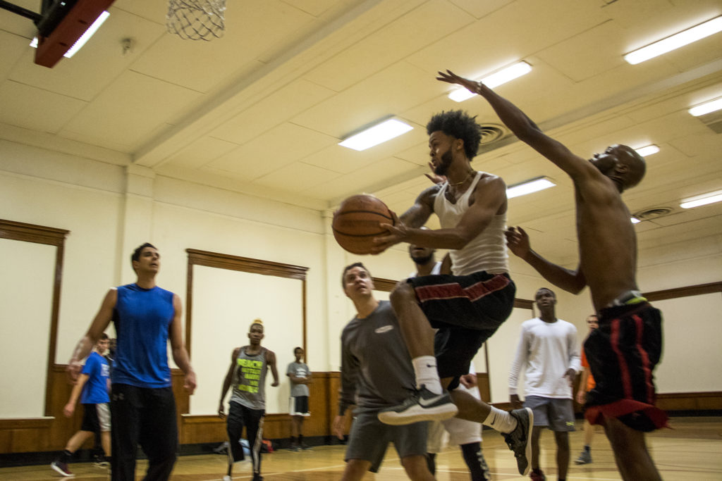 DeVarre Wright leaps for a basket during a pick-up game at the Twentieth Street Recreation Center downtown, Oct. 16, 2018. (Kevin J. Beaty/Denverite)